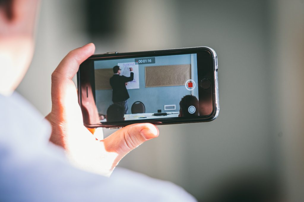 closeup of video taping on a smartphone of a facilitation session