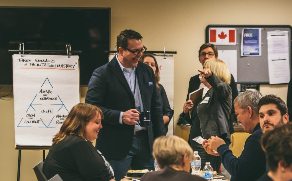 moe poirier in a crowd during facilitation session